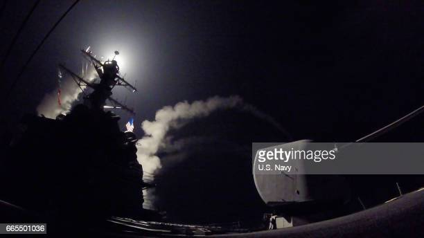 In this handout provided by the US NavyThe guidedmissile destroyer USS Porter fires a Tomahawk land attack missile on April 7 2017 in the...