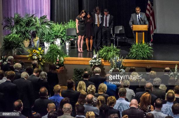 In this handout provided by The Warmbier Family people attend the funeral service of Otto Warmbier at Wyoming High School June 22 2017 in Wyoming...