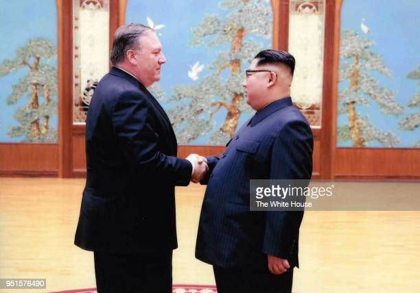 In this handout provided by The White House, CIA director Mike Pompeo shakes hands with North Korean leader Kim Jong Un in this undated image in...