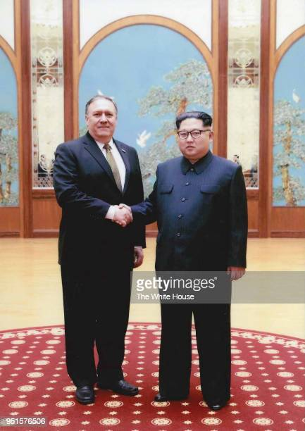 In this handout provided by The White House CIA director Mike Pompeo shakes hands with North Korean leader Kim Jong Un in this undated image in...