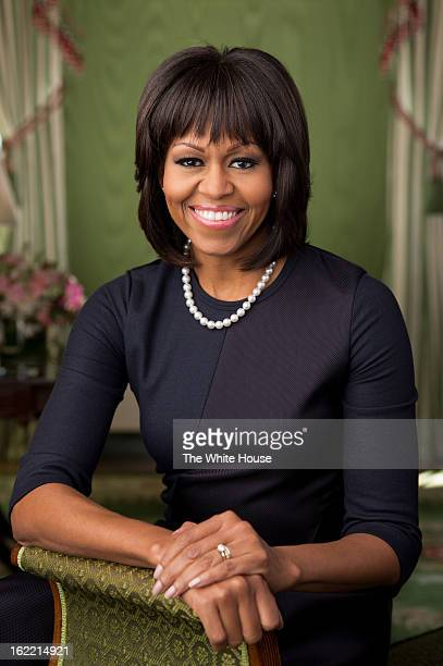 In this handout provided by the White House first lady Michelle Obama poses in the Green Room of the White House for her official photograph made...