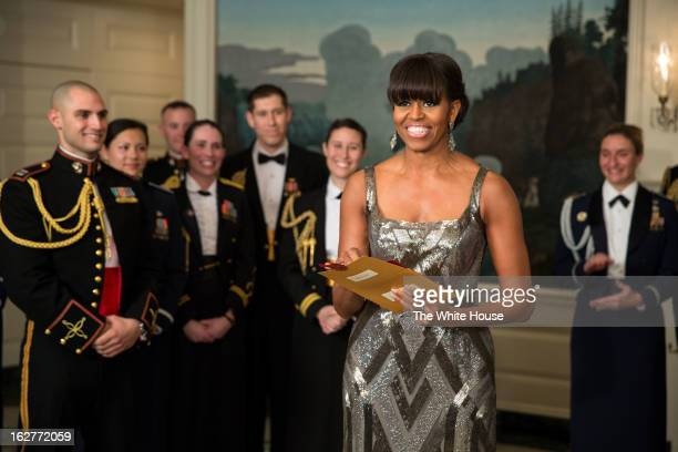 In this handout provided by The White House First lady Michelle Obama announces the Best Picture Oscar to Argo for the 85th Annual Academy Awards...
