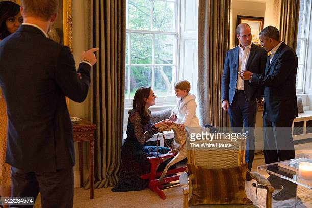 In this handout provided by The White House, President Barack Obama talks with the Prince William, Duke of Cambridge as Catherine, Duchess of...