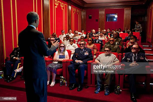 In this handout provided by the White House US President Barack Obama welcomes service members and their families to a screening of Men in Black 3 in...
