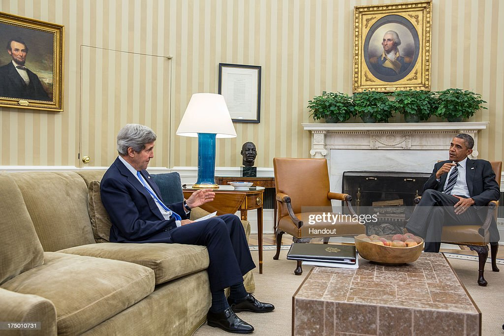 In this handout provided by the White House, U.S. President Barack Obama meets with Secretary of State John Kerry in the Oval Office, July 29, 2013 in Washington, D.C.