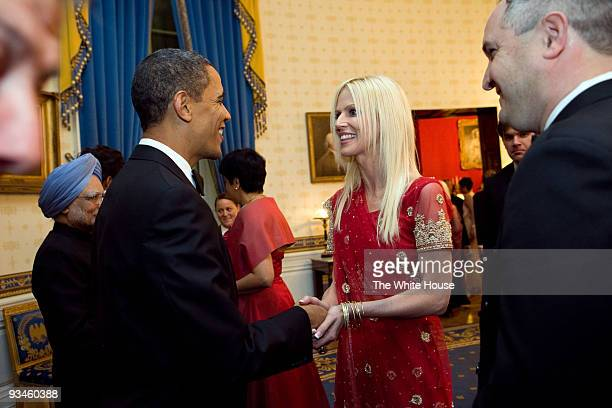 In this handout provided by the White House US President Barack Obama shakes hands with Michaele and Tareq Salahi of Virginia at the receiving line...