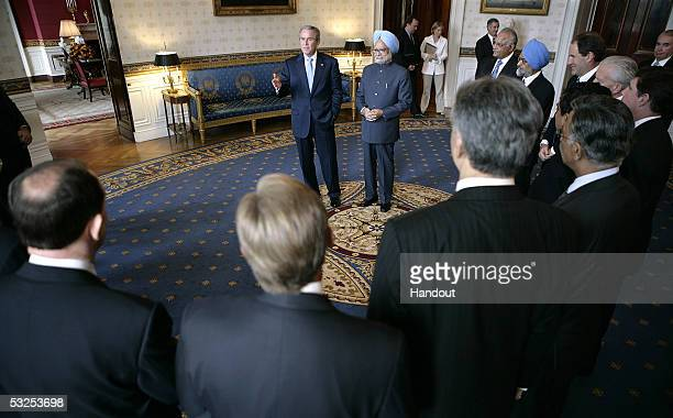 In this handout provided by the White House US President George W Bush stands with Prime Minister Manmohan Singh of India in the Blue Room of the...
