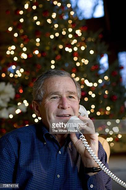 In this handout provided by The White House US President George W Bush makes Christmas Eve telephones calls to members of the Armed Forces December...