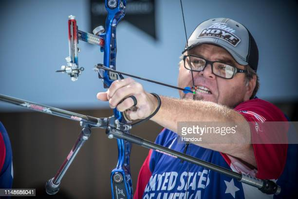 In this handout provided by the World Archery Federation, Eric Bennet of USA during the recurve men open finals during the S-Hertogenbosch 2019 World...