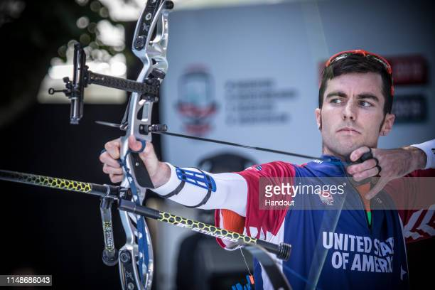 In this handout provided by the World Archery Federation, Timothy Palumbo of USA during the recurve men open team finals during the S-Hertogenbosch...