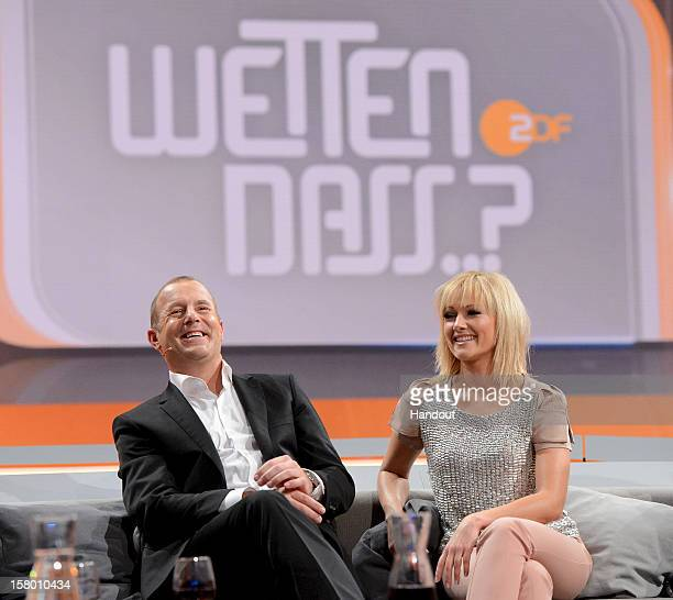 In this handout provided by the ZDF Heino Ferch and Helene Fischer sit on the couch at 'Wetten dass' From Freiburg on December 8 2012 in Freiburg im...