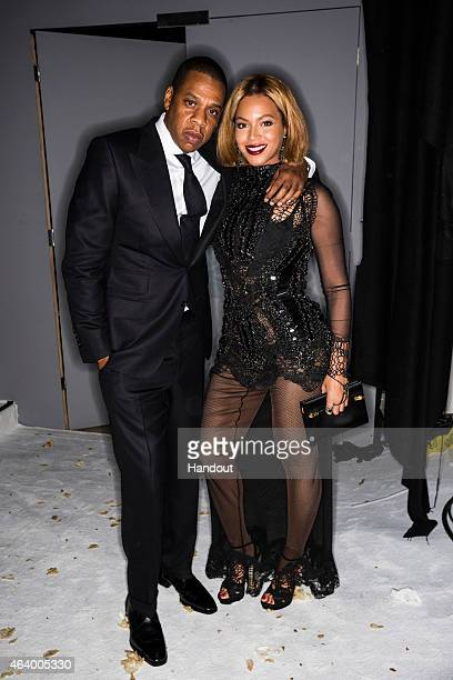 In this handout provided by Tom Ford, rapper Jay Z and singer Beyonce attend the TOM FORD Autumn/Winter 2015 Womenswear Collection Presentation at...