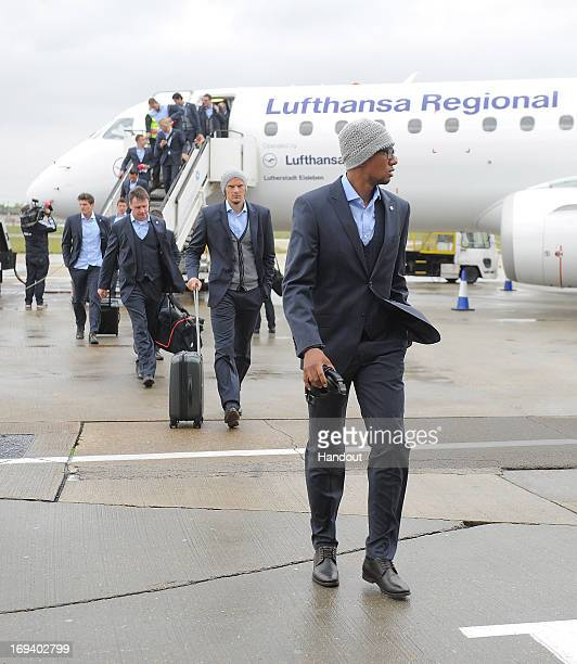 In this handout provided by UEFA Jerome Boateng of FC Bayern Munich arrives with his teammates at London City Airport on the eve of the UEFA...