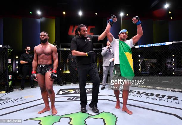 In this handout provided by UFC Gilbert Burns of Brazil reacts after his victory over Tyron Woodley in their welterweight fight during the UFC Fight...