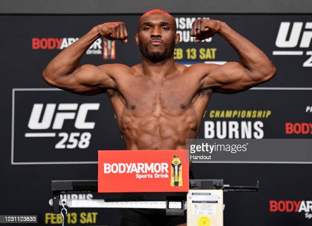 In this handout provided by UFC, Kamaru Usman of Nigeria poses on the scale during the UFC weigh-in at UFC APEX on February 12, 2021 in Las Vegas,...