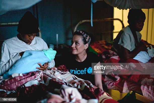 In this handout provided by UNICEF, UNICEF supporter Katy Perry visits new mothers at the Ampasina Maningory Health Centre in the village of Ampasina...