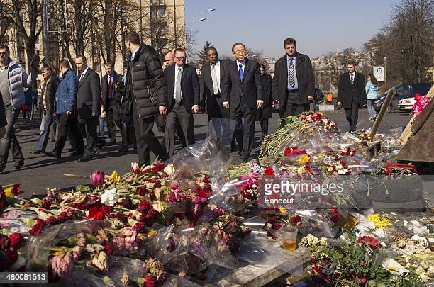 In this handout provided by United Nations UN SecretaryGeneral Ban Kimoon pays his respects at a makeshift memorial for all the victims of the recent...