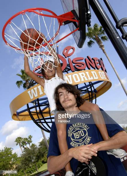 In this handout provided by Walt Disney World, Charlotte Bobcats forward Adam Morrison helps his six-year-old niece Shaeli Morrison make a slam dunk...