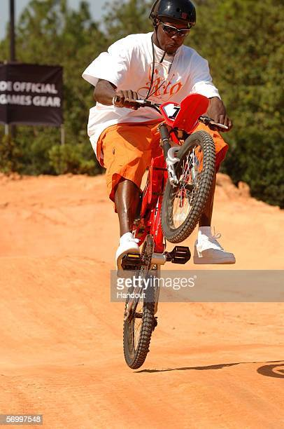 In this handout provided by Walt Disney World Cincinnati Bengals All Pro wide receiver Chad Johnson rides an ESPN XGames BMX bike on a specially...