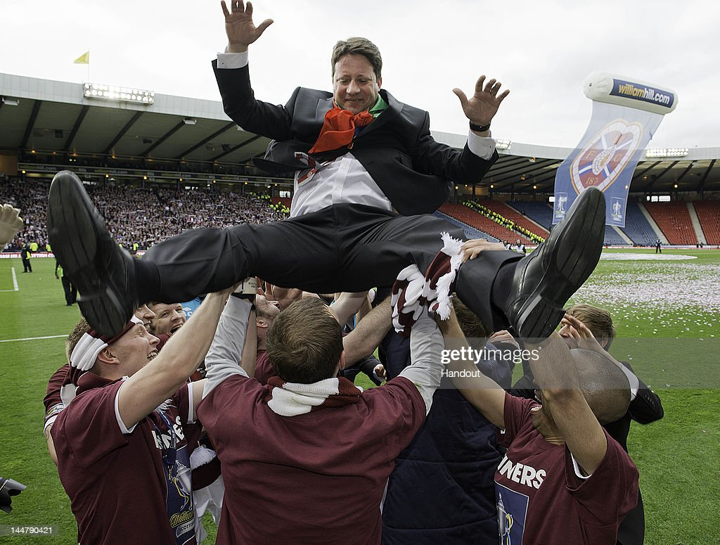 In this handout provided by William Hill, Coach Paulo Sergio of Hearts is lifted by players after winning William Hill Scottish Cup Final between Hibernian and Hearts at Hampden Park on May 19, 2012 in Glasgow, Scotland.