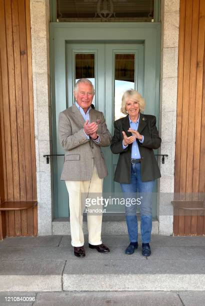 In this handout released by Clarence House, Prince Charles, Prince of Wales and Camilla, Duchess of Cornwall join in the 'clapping for our carers' at...