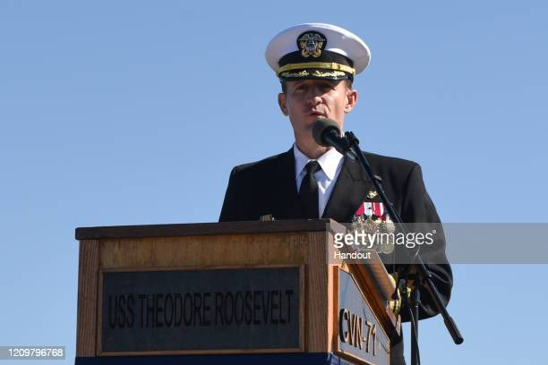 In this handout released by the US Navy Capt Brett Crozier addresses the crew for the first time as commanding officer of the aircraft carrier USS...