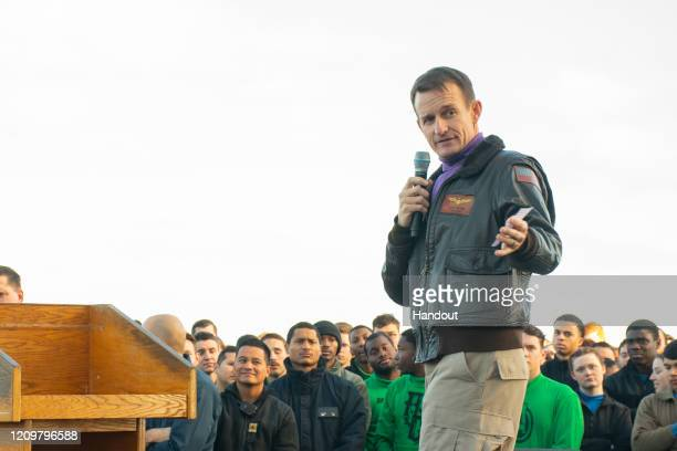 In this handout released by the US Navy Capt Brett Crozier commanding officer of the aircraft carrier USS Theodore Roosevelt gives remarks during an...