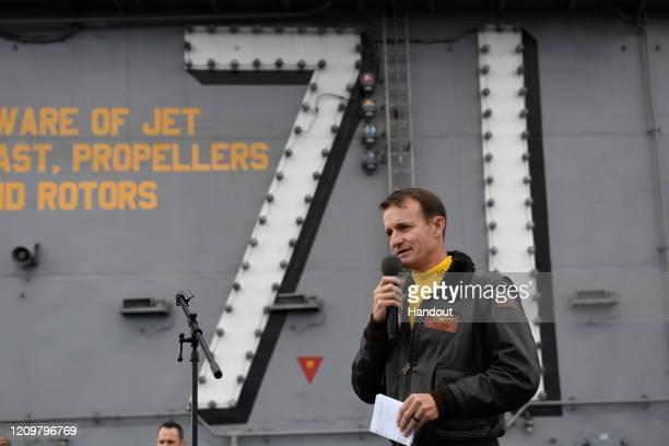 In this handout released by the US Navy Capt Brett Crozier commanding officer of the aircraft carrier USS Theodore Roosevelt addresses the crew...