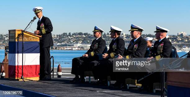 In this handout released by the US Navy Capt Carlos Sardiello commanding officer of the aircraft carrier USS Theodore Roosevelt gives remarks during...
