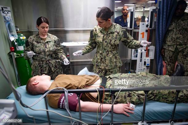 In this handout released by the US Navy Hospitalman Apprentice Nikki Capozello left from Margate Florida and Hospital Corpsman 3rd Class Rebekah...