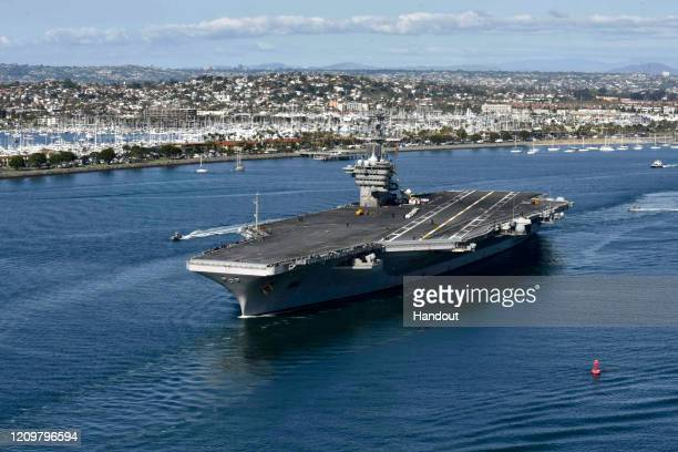 In this handout released by the U.S. Navy, The aircraft carrier USS Theodore Roosevelt leaves its San Diego homeport Jan. 17, 2020. The Theodore...