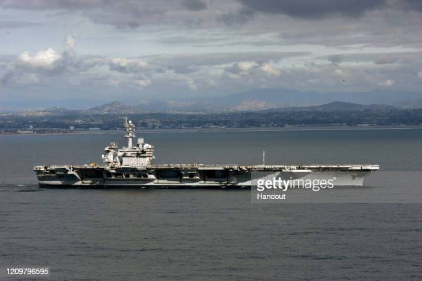 In this handout released by the US Navy The aircraft carrier USS Theodore Roosevelt leaves its San Diego homeport Jan 17 2020 The Theodore Roosevelt...