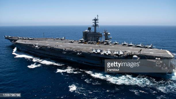 In this handout released by the US Navy The aircraft carrier USS Theodore Roosevelt transits the Pacific Ocean Theodore Roosevelt is conducting...
