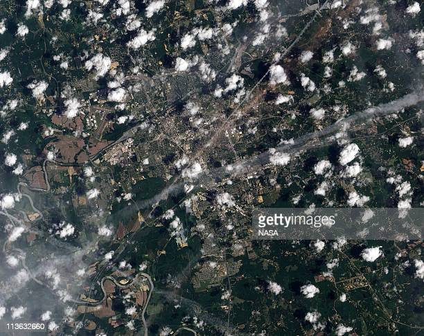 In this handout satellite image provided by NASA Earth Observatory destruction can be seen in the track left by a tornado on May 2 2011 as seen from...