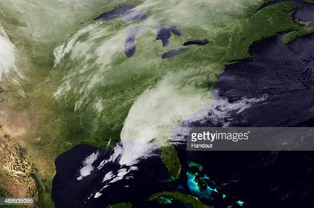 In this handout satellite image provided by National Oceanic and Atmospheric Administration a winter storm front moves through the Southern states on...