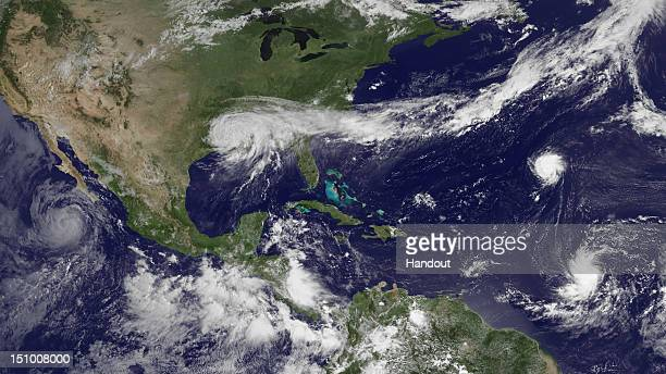 In this handout satellite image provided by National Oceanic and Atmospheric Administration Tropical Storm Isaac weakens as it moves further inland...