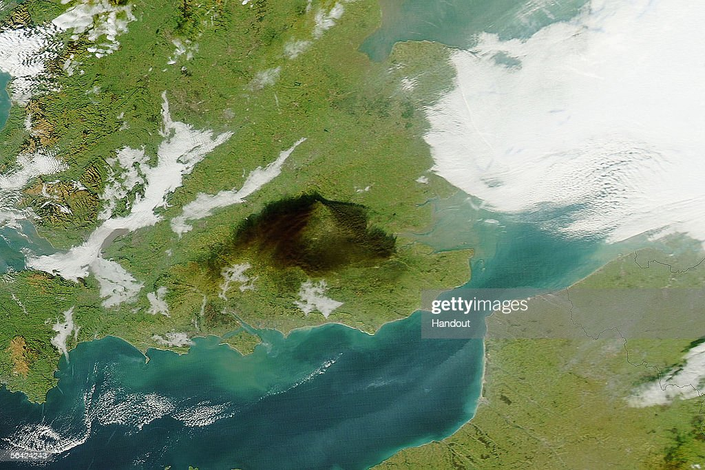 A satellite view of the vast extent of the smoke cloud which followed a massive explosion at Buncefield, one of the UK's biggest oil depots, on 11 December 2005