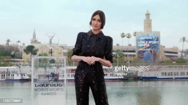 In this handout screengrab released on May 6, Host Paz Vega with a Laureus trophy during the Laureus World Sports Awards 2021 Virtual Award Ceremony...