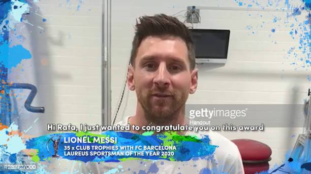 In this handout screengrab released on May 6 , Lionel Messi congratulates Rafael Nadal on winning the Laureus World Sportsman of the Year Award...