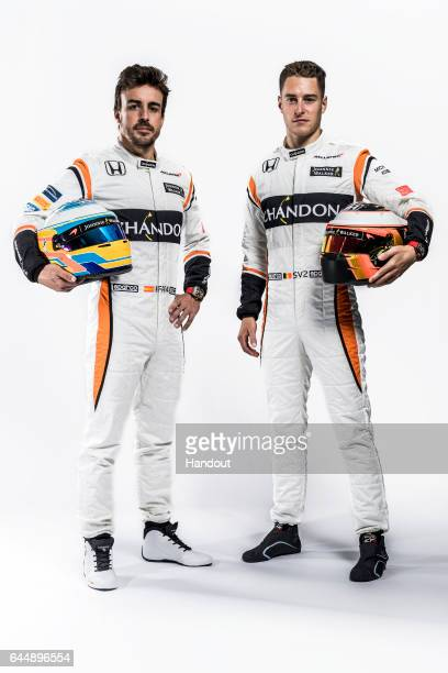In this handout supplied by McLaren F1 Fernando Alonso of Spain and Stoffel Vandoorne of Belgium attend the launch of the new McLaren Formula One car...