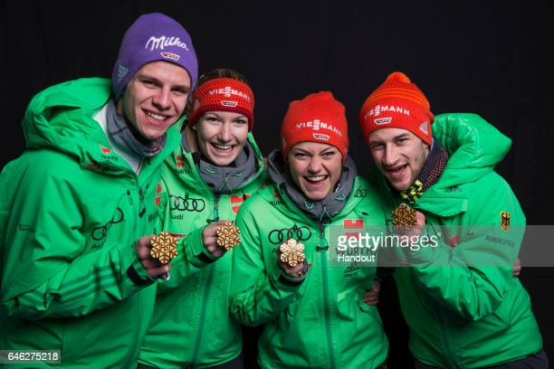 In this handout supplied by NordicFocus Andreas Wellinger Svenja Wuerth Carina Vogt and Markus Eisenbichler of Germany pose with their gold medals...