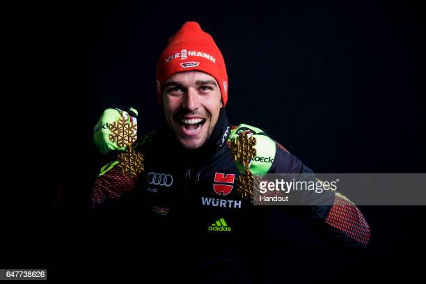 In this handout supplied by NordicFocus Johannes Rydzek of Germany poses with the four gold medals he won during the FIS Nordic World Ski...