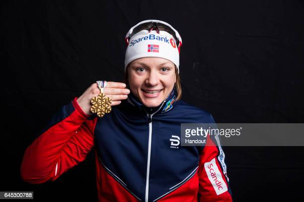 In this handout supplied by NordicFocus, Maiken Caspersen Falla of Norway poses with the Gold medal after the medal ceremony for the Women's 1.4 KM...