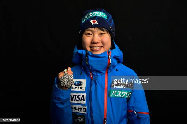In this handout supplied by NordicFocus Yuki Ito of Japan poses with the Silver medal after the medal ceremony for the Women's Ski Jumping HS100...
