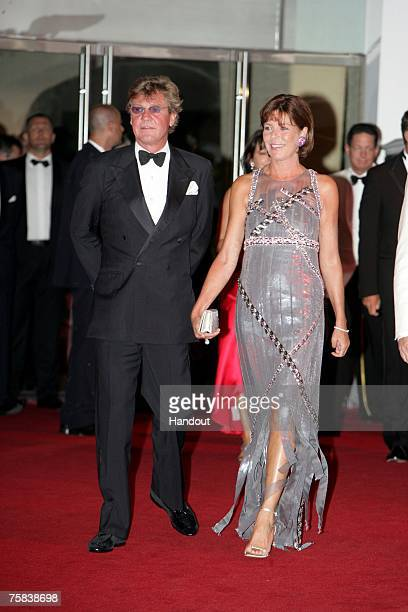 In this handout supplied by Realis/SBM Prince Ernst August and Princess Caroline of Hanover attend the 59th Red Cross Ball on July 27 2007 in Monte...