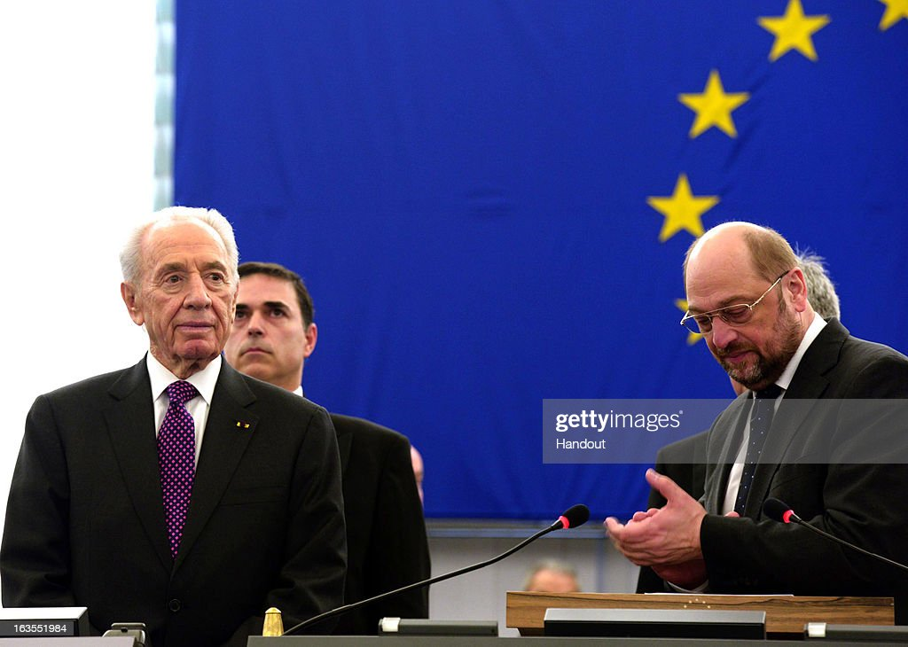 In this handout supplied by the Israeli Government press office (GPO), Israeli President Shimon Peres is applauded by European Parliament President Martin Schulz at the European Parliament, on March 12, 2013 in Strasbourg, France. Peres has been travelling between Brussels, Paris and Strasbourg to meet with leaders and address the European Parliament, a first for an Israeli leader.