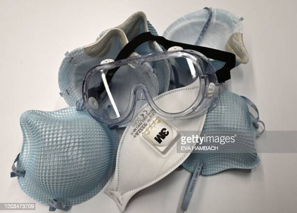 In this illustration dated February 26 protective N95 face masks lie on a table at an office in Washington DC A senior US health official warned that...
