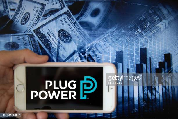 In this illustration is displayed on a smartphone's screen the company logo of Plug Power, which specialises in design and manufacturing of hydrogen...