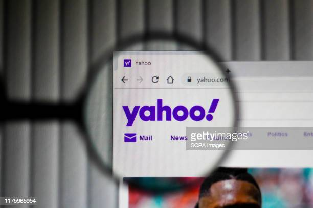 In this illustration the homepage of the Yahoo website is seen displayed on the computer screen through a magnifying glass.