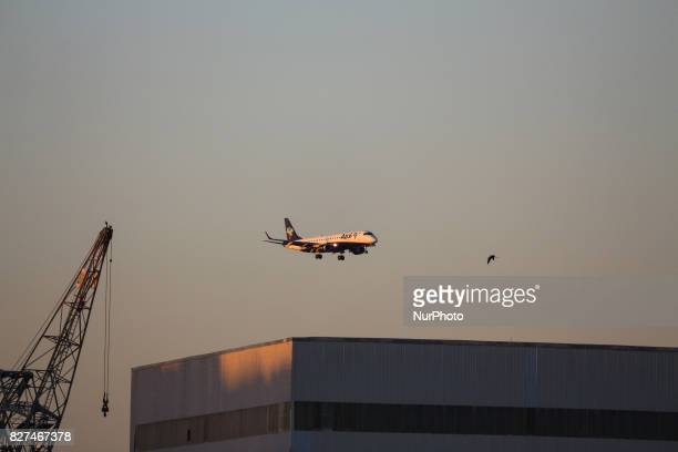 In this image Azul's plane overfly waters from Guanabara Bay to land at Santos Dumont Airport Downtown Rio